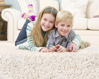 girl and boy smiling on clean carpet in Napa Ca